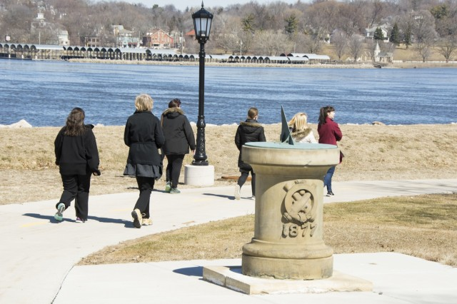 Participants in the Fit Food Challenge walk along the Mississippi River March 15 during one of the biweekly walks held as part of the challenge. (Photo by Kevin Fleming, ASC Public Affairs)
