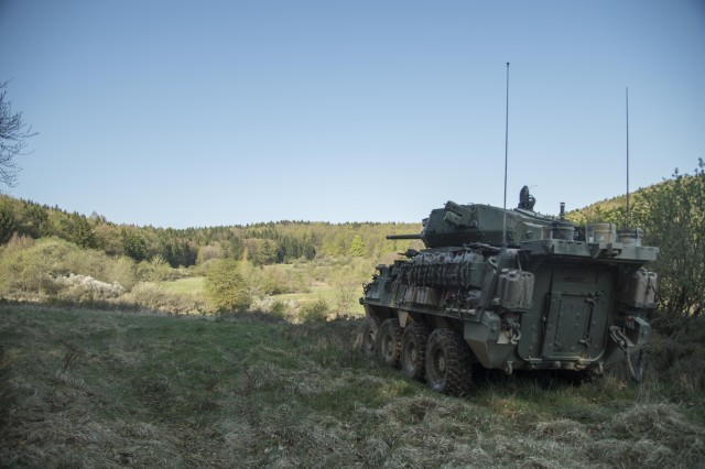 An Infantry Carrier Vehicle Dragoon (ICVD) from Palehorse Troop, 4th Squadron, 2nd Cavalry Regiment, over watching a Named Area of Interest as part of a Screen Mission during the Infantry Carrier Vehicle Dragoon (ICVD)/Common Remote Weapons Station mounting a Javelin missile (CROWS-J) Operational Test Operational Test at the Joint Maneuver Readiness Center (JMRC), Hohenfels, Germany.