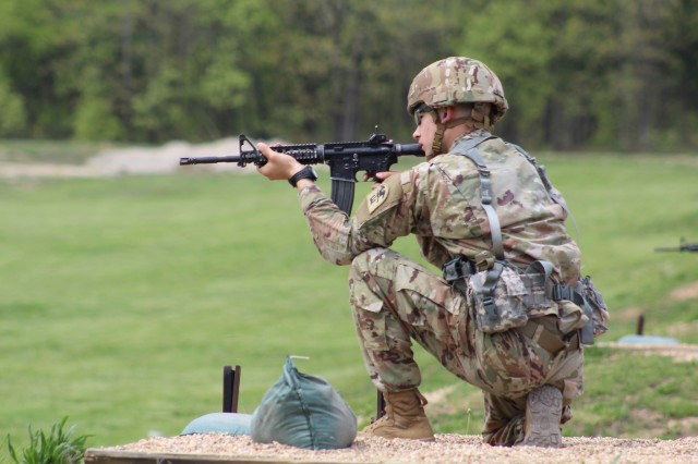 Soldier of the Year, Pfc. David Cox, qualifies with his weapon at Range 3 on Day 1.