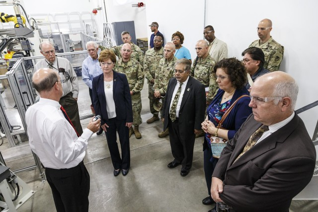 Distinguished guests tour the Anniston Munitions Center's new Multiple Launch Rocket System Recycle Facility in a ceremony, May 17.