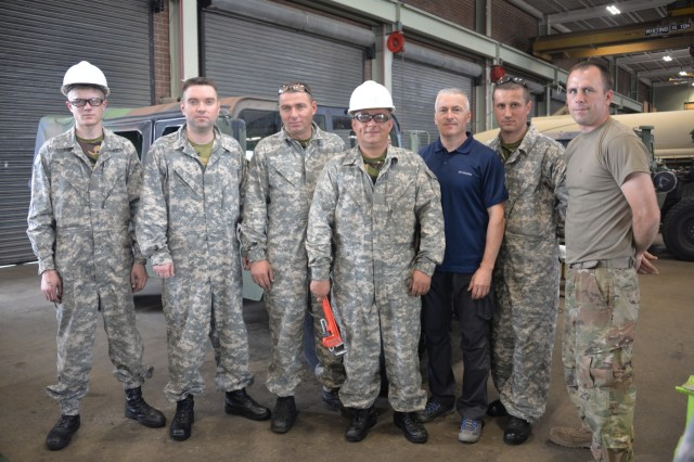 Chief Warrant Officer 2 Jesse Wisecup stands with the Moldovan Defense Forces Soldiers as they complete their week long maintenance engagement on the fundamentals of Humvee maintenance and troubleshooting with minimal technology at the North Carolina National Guard Combined Support Maintenance Shop in Raleigh, North Carolina, May 17, 2018. The North Carolina National Guard and the Moldovan Defense Forces have been hosting bi-lateral engagements through the State Partnership Program that has allowed Soldier growth and development for both countries.