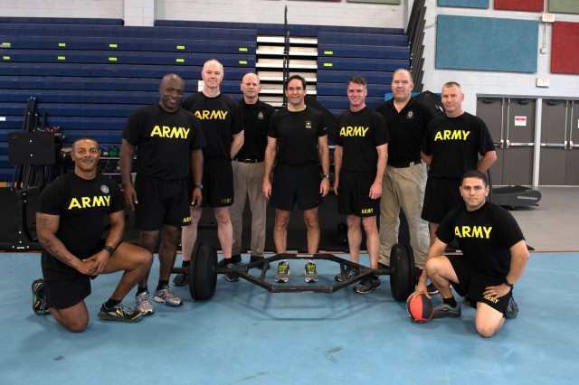 Secretary of the Army Dr. Mark T. Esper stands for a photo with members of U.S. Army Training and Doctrine Command's Center for Initial Military Training after a morning physical training session May 18, 2018. The physical training was part of Esper's visit to U.S. Army Training and Doctrine Command, where he met with senior TRADOC leaders, visited the Army Capabilities Integration Center, met with junior spouses, observed Army watercraft training and 128th Aviation Maintainer Advanced Individual Training.