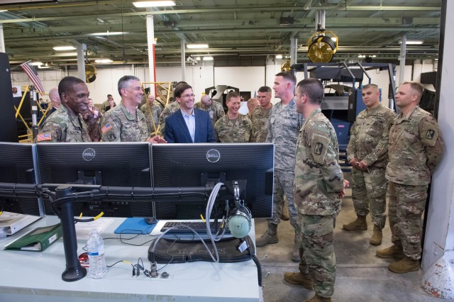 Secretary of the Army Dr. Mark T. Esper talks with students and instructors from the 128th Aviation Brigade on Fort Eustis, Virginia, May 18, 2018. The 128th was one of Esper's stops during his visit to to U.S. Army Training and Doctrine Command, where he met with senior TRADOC leaders, visited the Army Capabilities Integration Center, met with junior spouses and observed Army watercraft training.