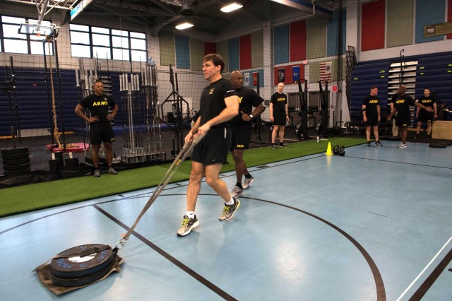 Secretary of the Army Dr. Mark T. Esper participates in a morning physical training session, May 18, 2018. The physical training was part of Esper's visit to U.S. Army Training and Doctrine Command, where he met with senior TRADOC leaders, visited the Army Capabilities Integration Center, met with junior spouses, observed Army watercraft training and 128th Aviation Maintainer Advanced Individual Training.