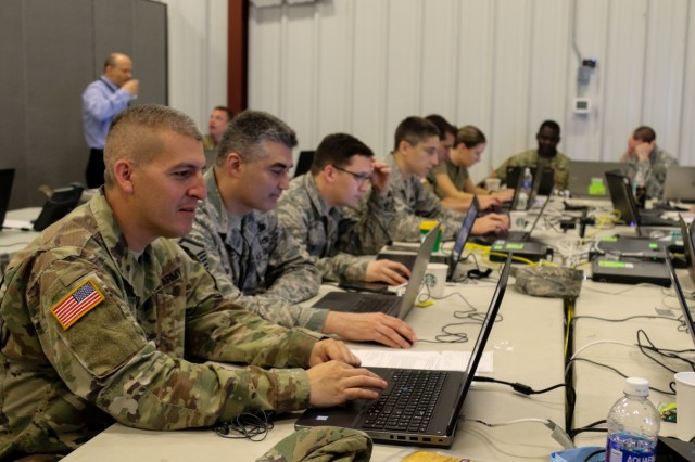 Soldiers and Airmen monitor network traffic for malicious intrusion May 18, 2018, at Cyber Shield 18, a two week long exercise at Camp Atterbury, Ind., May 18, 2018. The event brings together more than 800 Soldiers, Airmen, federal and state agencies, and civilian partners from 40 states and territories to test their skills in response to cyber-incidents.