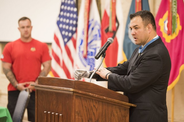 Retired Master Sgt. Leroy Petry, a Medal of Honor recipient and wounded warrior, discusses his personal struggles with mental health and the work he does to assist fellow Soldiers, veterans and others during a Mental Health Awareness Observance May 17, Heritage Hall, Rock Island Arsenal, Illinois.