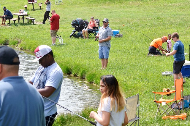 Families line the banks of Moon Lake, Fort Riley, Kansas, May 12 during the annual Kid's Fishing Day. The event had been postponed earlier because of bad weather. Fort Riley has 29 fishing ponds, but with the current drought, only 15 ponds currently are being managed, according to officials.
