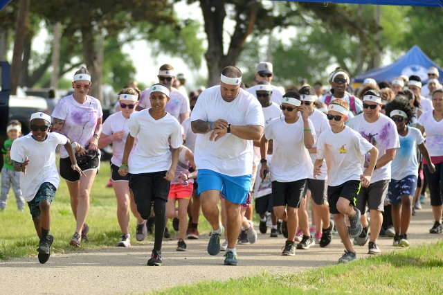 Approximately 300 runners begin the Family and Morale, Welfare and Recreation Rainbow Road Run May 13 at Riley's Conference Center, Fort Riley, Kansas.