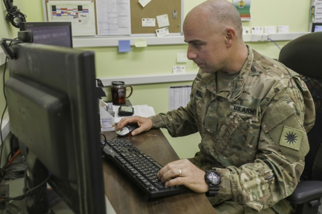 U.S. Army Maj. Nathan Wall, deputy logistics officer for Train, Advice and Assist Command-South, works in his office, May 20, 2018, at Kandahar Airfield, Afghanistan.
