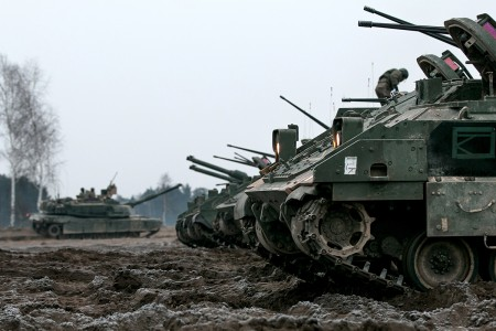 Bradley Fighting Vehicles idle on the fields of Presidenski Range in Trzebian, Poland, during a platoon combined arms live fire exercise, March 26, 2018.