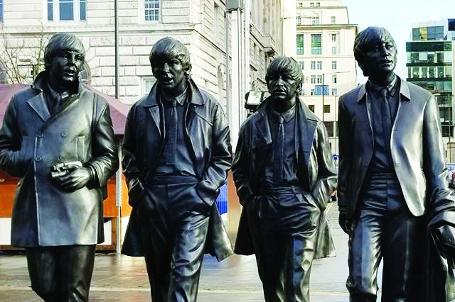 The Beatles sculpture on Pier Head, Liverpool, England. The city is where John Lennon, Paul McCartney, George Harrison and Ringo Starr formed the band in 1960.
