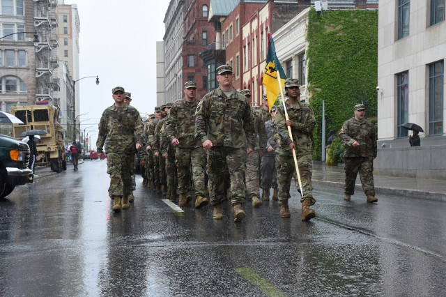 Members of the Pennsylvania Army National Guard's 55th Maneuver Enhancement Brigade brave the rain to march in the 2018 Scranton Armed Forces parade.