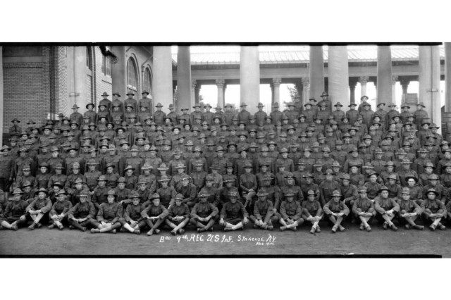 U.S. Army Soldiers of Company B, 9th Infantry Regiment pose in 1917 at Camp Syracuse, N.Y. The regiment provided training to new recruits and National Guard Citizen Soldiers in America's mobilization for World War I. Camp Syracuse, located on a portion of the New York state fairgrounds, processed more than 40,000 Soldiers for the war effort.