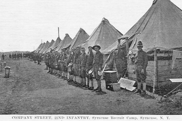 U.S. Army Soldiers stand on a typical company street at Camp Syracuse, N.Y., in 1918. The camp provided training to new recruits and National Guard Citizen Soldiers in America's mobilization for World War I. Camp Syracuse, located on a portion of the New York state fairgrounds, processed more than 40,000 Soldiers for the war effort.