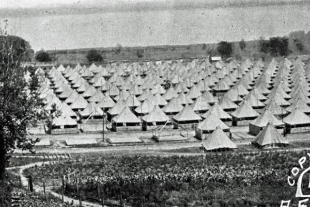 """The U.S. Army recruit training camp seen in 1918 in Syracuse, N.Y. The camp provided training to new recruits and National Guard Citizen Soldiers in America's mobilization for World War I. Known as Camp Syracuse, located on a portion of the New York state fairgrounds, the center processed more than 40,000 Soldiers. The camp transitioned in the summer of 1918 to train draftees with medical limitations for """"special and limited service."""" These Soldiers were otherwise unqualified for combat duties, but still expected to serve in rear echelons or on the home front."""