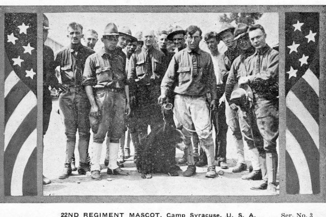 U.S. Army Soldiers of the 22nd Infantry Regiment pose in 1918 with their unit mascot, a black bear cub, at Camp Syracuse, N.Y. The regiment provided training to new recruits and National Guard Citizen Soldiers in America's mobilization for World War I. Camp Syracuse, located on a portion of the New York state fairgrounds, processed more than 40,000 Soldiers for the war effort.