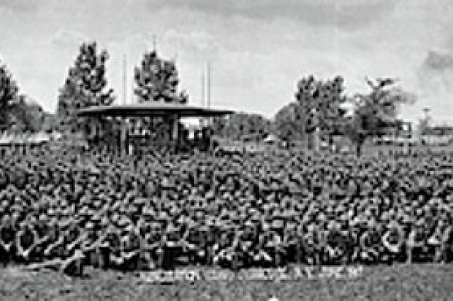 U.S. Army Soldiers from the Camp Syracuse Recruit Training Camp pose in 1917. The regiment provided training to new recruits and National Guard Citizen Soldiers in America's mobilization for World War I. Camp Syracuse, located on a portion of the New York state fairgrounds, processed more than 40,000 Soldiers for the war effort.