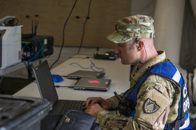 Sgt. 1st Class Roscoe Driscoll, an information technology specialist with 521st Troop Command Battalion, Maine Army National Guard works to set up the command and control tent as part of an exercise to test the New England Chemical Biological Radiological Nuclear (CBRN) Enhanced Response Package's (CERF-P) response to a CBRN event at Joint Base Cape Cod, Buzzards Bay, Massachusetts May 15, 2018.  Soldiers and Airmen from Maine, Vermont, New Hampshire, Rhode Island, and Massachusetts are participating.  Each team will be scored on their performance and will help the units gage their readiness in case of a real emergency.