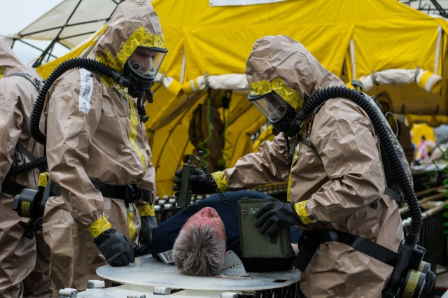 An actor is checked for residual radiological contamination after going through a decontamination shower as part of an exercise to test the New England Chemical Biological Radiological Nuclear (CBRN) Enhanced Response Package's (CERF-P) response to a CBRN event at Joint Base Cape Cod, Buzzards Bay, Massachusetts May 16, 2018.  Soldiers and Airmen from Maine, Vermont, New Hampshire, Rhode Island, and Massachusetts are participating.  Each team will be scored on their performance and will help the units gage their readiness in case of a real emergency.  If they are ruled proficient in all their tasks, their team will become rectified.