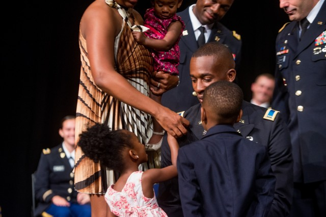 COLUMBUS, Ga. (May 21, 2018) - The Family of 2nd Lt. Allen Ransom pin his rank insignia onto his shoulders during an ROTC commissioning ceremony. The Reserve Officers' Training Corps at Columbus State University in Columbus, Georgia, held a commissioning ceremony May 18 at the university, during which five cadets became officers in the U.S. Army. (Photo by Patrick A. Albright, Maneuver Center of Excellence, Fort Benning Public Affairs)