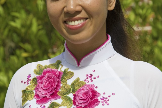 1st Lt. Diana White, a military intelligence officer and Vietnam native with 603rd Aviation Support Battalion, 3rd Combat Aviation Brigade, 3rd Infantry Division, wears a traditional Vietnamese gown called an Ao Dai, May 21, 2017, at Hunter Army Airfield, Ga. White, originally born in Vietnam, commissioned to be a military intelligence officer in 2016. (U.S. Army photo by Spc. Zoe Garbarino/Released)