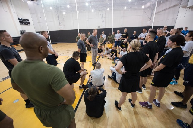 Army Command Sgt. Maj. John W. Troxell, senior enlisted advisor to the chairman of the Joint Chiefs of Staff, hosts a physical training session with Deputy Defense Secretary Patrick M. Shanahan and service members from across the joint force at the inaugural DOD Readiness and Resilience Workshop at Fort McNair in Washington, April 17, 2018. The workshop featured speakers and covered topics to optimize human performance through the body, mind, and spirit.