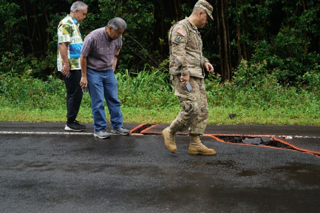 Brig. Gen. Kenneth Hara, Hawaii National Guard deputy adjutant general, and Hawaii Governor David Ige (center), look at an earthquake damaged roadway in Leilani Estates, May 08, 2018, Pahoa Hawaii. The Hawaii National Guard has been activated to assist Hawaii County government agencies in response to the volcanic outbreak.
