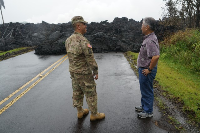 Brig. Gen. Kenneth Hara, Joint Task Force 5-0 commander, and Hawaii Governor David Ige examine an area in Leilani Estates where lava over ran the road, May 08, 2018, Pahoa Hawaii.