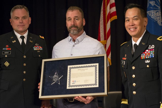 Colonel Philip M. Secrist III, Eric Smith and Brigadier General R. Mark Toy during the Star of Life Award presentation.