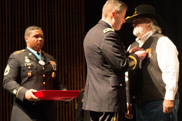 Maj. Gen. Robert P. Walters Jr., Commander of U.S. Army Intelligence Center of Excellence and Fort Huachuca, presents Mr. Frank Crary, with the Distinguished Service Cross for his extraordinary heroism during the Vietnam War.