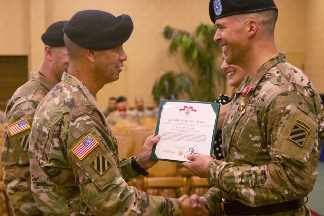 Brig Gen. Sean C. Bernabe, the 3rd Infantry Division Task Force Marne commander, received the Legion of Merit from Maj. Gen. Lee Quintas during a farewell ceremony, May 17, 2018, at Fort Stewart, Ga. During his time serving as the Task Force Marne Commander, Bernabe supervised the division's preparation for multiple brigade-level deployments that included 3rd Division Sustainment Brigade and 3rd Combat Aviation Brigade to Afghanistan, and 1st Armored Brigade Combat Team to the Republic of Korea. (U.S. Army photo by Sgt. Arjenis Nunez/Released)
