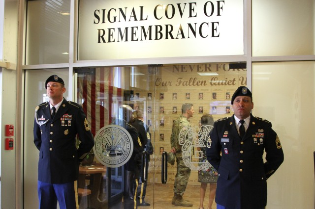 Members of the NETCOM honor guard stand watch over the Signal Cove of Remembrance during a rededication and memorial ceremony, May 23, at the NETCOM headquarters, Fort Huachuca, Ariz.