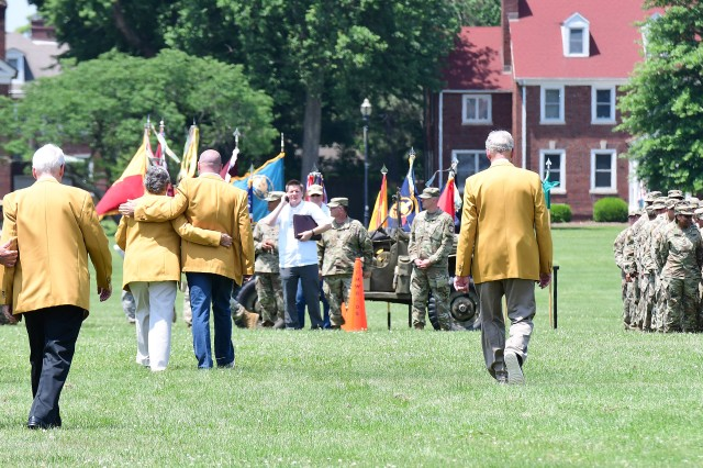Gold Neighbors walk to their places in the center of the formation May 23, 2018, as Ryan Brus (center), Fort Knox PAO, directs them.
