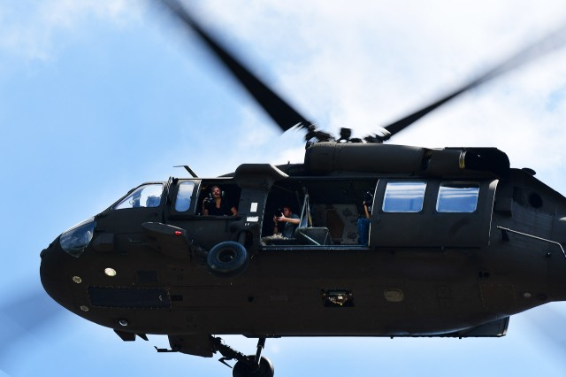 Film and photo crews prepare to capture the historic moment May 23, 2018, as they are transported by a helicopter crew from 8th Battalion, 229th Aviation Regiment at Fort Knox.