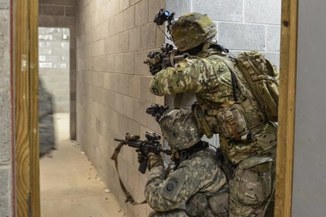 Paratroopers assigned to Alpha Company, 1st Battalion, 508th Parachute Infantry Regiment provides security on a hallway during a nighttime air assault of a simulated enemy compound during urban warfare training at Fort A.P. Hill, Virginia in March.