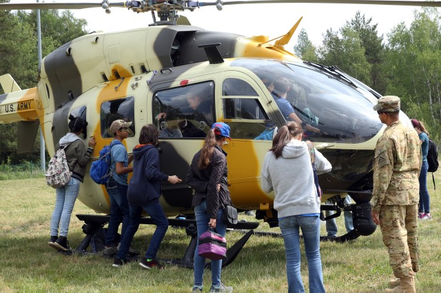 Soldiers assigned to the Joint Multinational Readiness Center demonstrate the operability of a UH-72 Lakota Light Utility Helicopter to school children from the Hohenfels Middle/High School during Job Shadow Days at Hohenfels Training Area, Hohenfels, Germany, May 17, 2018. Job Shadow Days is an annual three-day event where school children from both the Hohenfels Elementary School, and Hohenfels Middle/High School are shown various military occupational skills that are present at HTA.