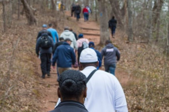 """Soldiers from the Department of the Army Inspector General's Assistance Division hike the trail along Bull Run, upstream from the Stone Bridge, during an April 12 """"staff ride"""" at Manassas National Battlefield Park. Nearly 30 members of the Assistance Division took part in the event."""