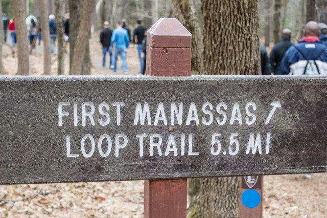 """Nearly 30 members of the Department of the Army Inspector General's Assistance Division visited Manassas National Battlefield Park April 12 for a """"staff ride."""" The group hiked the Manassas Loop, a 5.5-mile trail that takes visitors through several notable sites of the Civil War's historic Battle of Manassas."""
