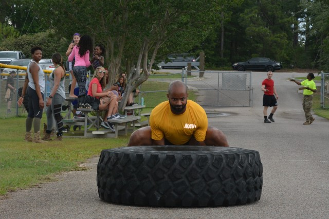 Navy Petty Officer Ismael D. Quinones competes in the tire flipping contest during the annual Fort Jackson Strongman Competition May 17.