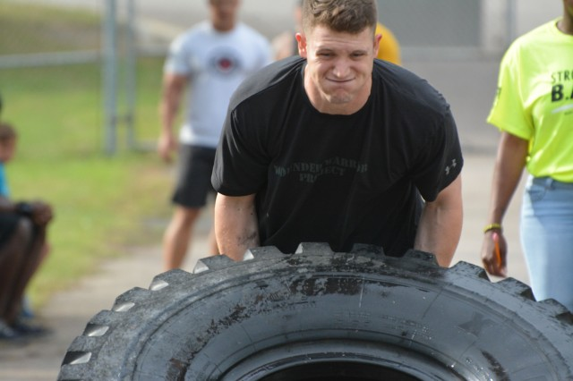 Capt. Andrew Butler competes in the tire flipping contest during the Fort Jackson Strongman Competition May 17 at the  Hilton Field Sports Complex.