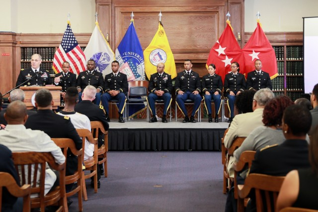 Gen. Gus Perna, commander of Army Materiel Command, gives leadership advice to seven graduating cadets at the Howard University Commissioning Ceremony, May 10. Following his remarks, Perna administered the oath of office, commissioning the cadets as second lieutenants.