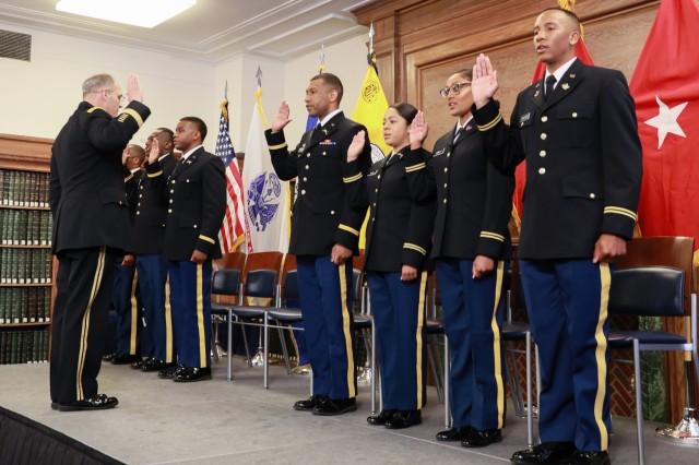 Gen. Gus Perna, head of Army Materiel Command, administers the oath of office to seven ROTC cadets during the Howard University Commissioning Ceremony, May 10. Perna told the new second lieutenants to be confident, committed, and of high character.
