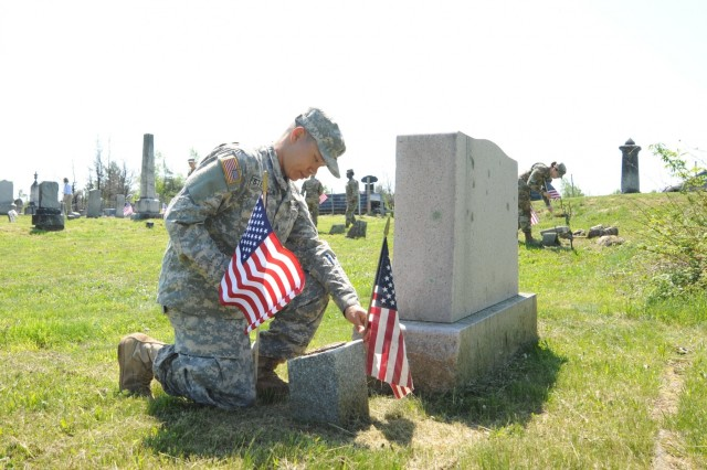 "Sgt. Peter Stephenson, from 543rd Composite Supply Company, 548th Combat Sustainment Support Battalion, 10th Mountain Division Sustainment Brigade, was among the 10th Mountain Division (LI) Soldiers planting flags May 24 at cemeteries located in the ""Lost Villages"" at Fort Drum"