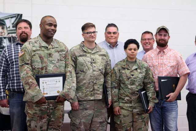 Master Sgt. Robert Craft, Spc. Trestan Garcia, Spc. Tianna Harris, and former Sgt. Chad Berry (with beard) are the first graduates of the Warren CAT program. They stand with Warren CAT administrators May 18, 2018, at the Fort Sill Soldier for Life - Transition Complex after the graduation ceremony. Craft is assigned to Fort Riley, Kan.; Garcia is from Fort Hood, Texas; Harris is with the 75th Field Artillery Brigade here; and Berry, who separated from the Army during the training, was also from Fort Hood.