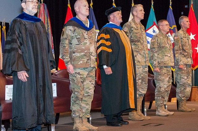 Command and General Staff College officials prepare to recognize graduates of the School of Advanced Military Studies at Fort Leavenworth. (l-r) Dr. Robert Baumann, Director of Graduate Studies; Col. James Markert, SAMS Director; Dr. James Martin, Dean of Academics; Brig. Gen. Scott Efflandt, Deputy Commandant; Lt. Gen. Michael Lundy, Commander of the Combined Arms Center and Fort Leavenworth and Commandant of CGSC; and guest speaker Maj. Gen. James F. Pasquarette, Commander U.S. Army Japan.