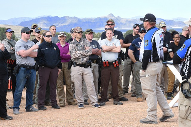 At the seventh annual Tactical Top Shot 3-gun competition at Dugway Proving Ground, Utah, a run-through of the course before the competition begins is essential. The May 18, 2018 event was open to 75 Utah military and law enforcement members. Photo by Al Vogel, Dugway Proving Ground Public Affairs.