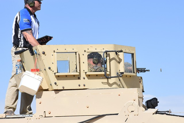 "The May 18, 2018 Tactical Top Shot 3-Gun Competition at Dugway Proving Ground, Utah had an interesting ""hide"" for the long-range rifle event: a 14-ton Mine-Resistant Ambush Protected (MRAP) truck. Shooters engaged seven targets at 55 to 500 yards. Most of the event's 75 shooters were law enforcement officers throughout Utah. Photo by Al Vogel, Dugway Proving Ground Public Affairs."
