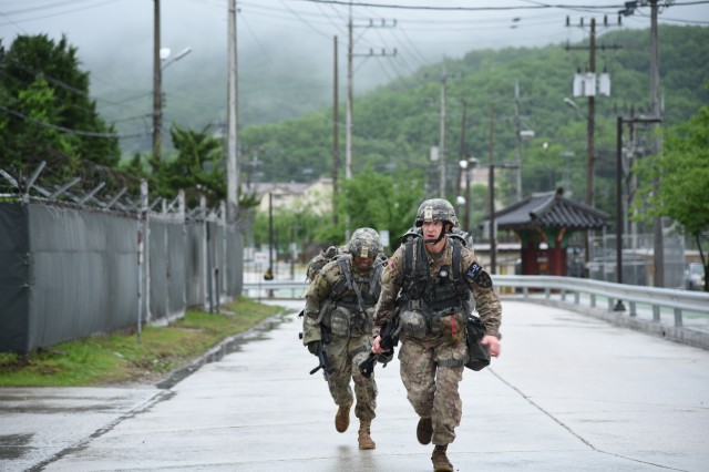 Warrant Officer David Hobart (Front), assigned to 2nd Infantry Division and Cpt. Esau Brown (Back), assigned to Eighth Army, conduct a 12-mile foot march during the Eighth Army 2018 Best Warrior Competition, held at Camp Casey, Republic of Korea, May 18.