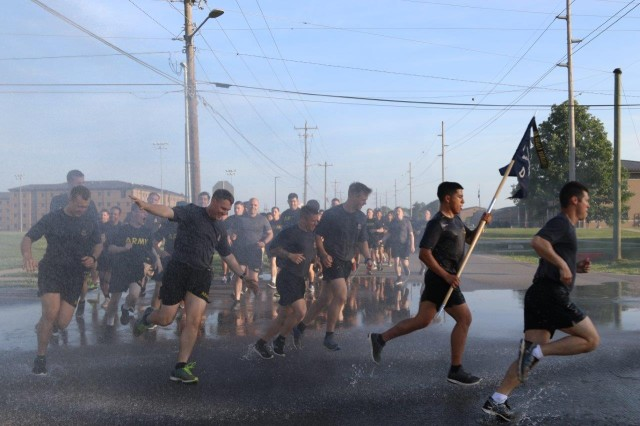Soldiers from 101st Airborne Division (Air Assault), get sprayed by a hose as they run four miles in a division run celebrating the division's Day of the Eagles, May. 24 on Fort Campbell, Ky. Day of the Eagles was a tradition started in 1973 as an effort to reinvigorate the sense of community and is still carried on today to also honor those who served.