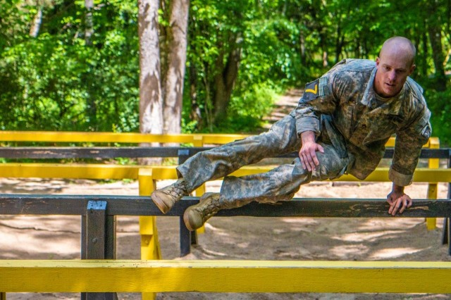 Staff Sgt. Theodore Flick, 3rd Brigade Combat Team, 101st Airborne Division (Air Assault), navigates the six vaults obstacle during the Best Air Assault Competition at The Sabalauski Air Assault School May 24 at Fort Campbell. This competition was part of the Day of the Eagles, and Air Assault qualified Soldiers of the 101st competed in various events such as a 12 mile road march, in hopes of being named the Best Air Assault team